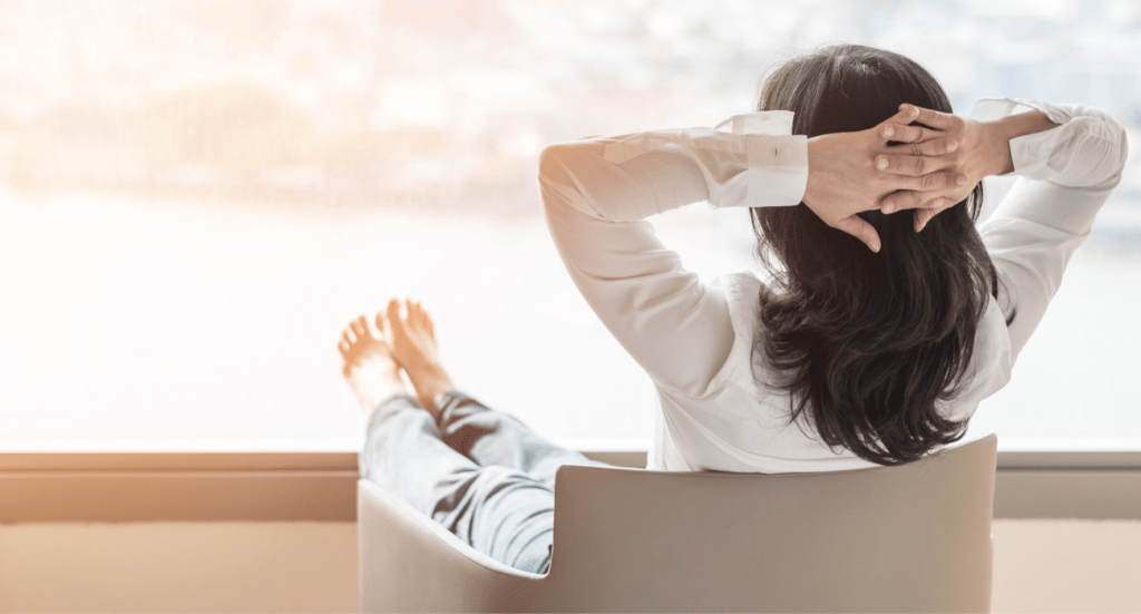 women with complete peace of mind relaxing with feet up
