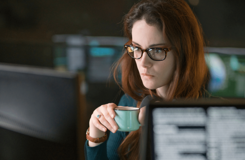 women drinking coffee while on computer