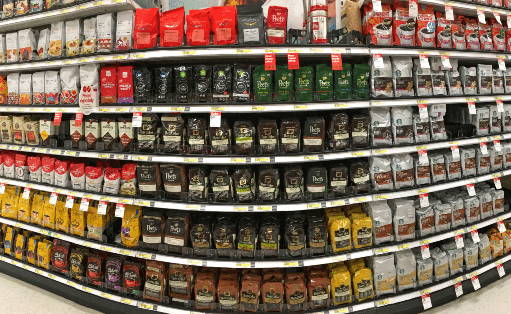 bags of coffee in store aisle